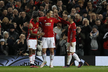 Manchester United's Zlatan Ibrahimovic celebrates with  Henrikh Mkhitaryan and Marcus Rashford after Feyenoord's Brad Jones scores an own goal and the third for Manchester United