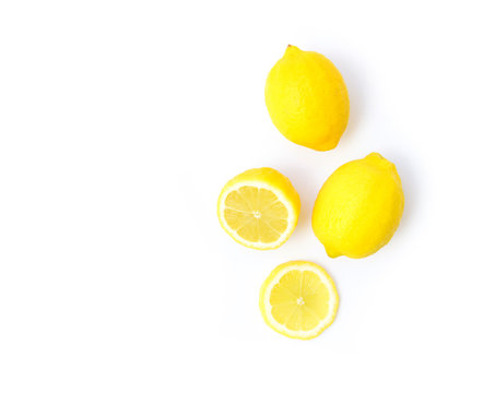 Closeup top view fresh lemon fruit and slice on white background