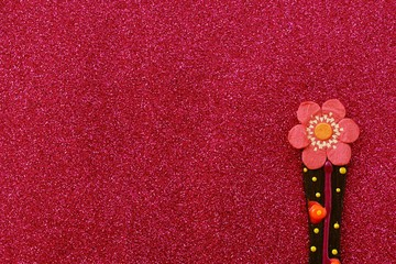 Lovely flower decoration on glitter paper texture background