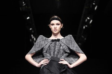 A model presents a creation by Peruvian designer Alvarez-Calderon during Lima Fashion Week in Lima