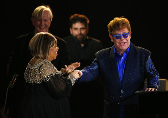 """Elton John shakes hands with Mavis Staples' after performing """"The Weight"""" at the 55th annual Grammy Awards in Los Angeles"""
