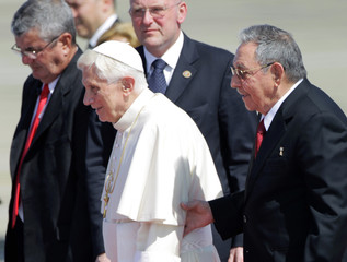 Pope Benedict XVI and Cuba's President Raul Castro walk together after the Pope's arrival in Santiago de Cuba