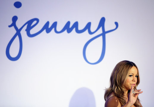 Mariah Carey waves during a press conference announcing that she will be the new brand ambassador for the weight-loss program Jenny in New York