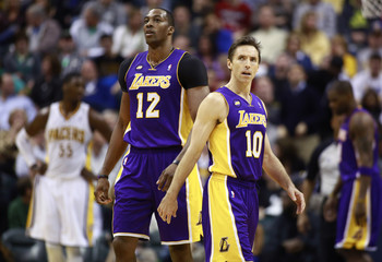 Lakers' Howard and Nash walk up the floor during the second half of an NBA basketball game against the Pacers in Indianapolis