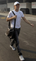 Mercedes Formula One driver Rosberg arrives at the Buddh International Circuit in Greater Noida for the first practice session of the Indian F1 Grand Prix