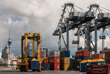 Auckland port with container cranes and shipping freight containers