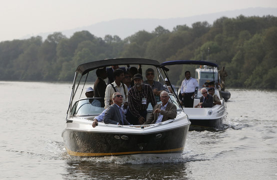 Britain's Prince Charles looks up to the sky during a visit to a mangrove conservation area in Mumba