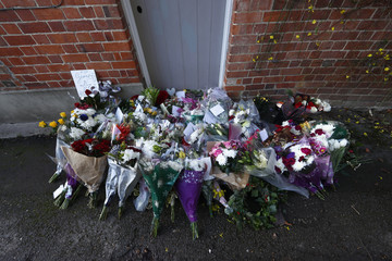 Floral tributes are seen outside the house of singer George Michael, where he died on Christmas Day, in Goring, southern England