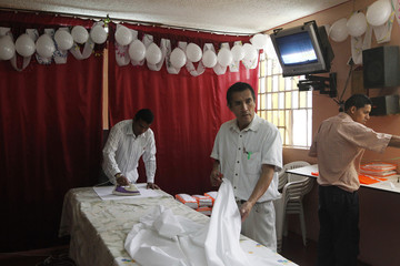 Prisoners work at a textile workshop inside a room at Lurigancho prison in Lima