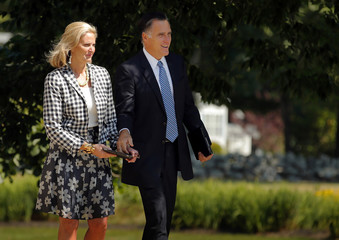 Republican presidential candidate and former Massachusetts Governor Mitt Romney and his wife Ann leave after services at The Church of Jesus Christ of Latter-Day Saints in Wolfboro