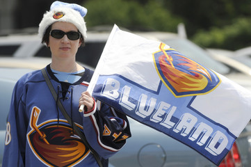 Thrashers fan Adams wears her Thrashers spirit wear during a rally organized to keep the Atlanta Thrashers hockey team from being sold and moved out of the city in Atlanta.