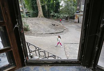 "A girl walks in the courtyard of the ""Gesu Squat"" in Brussels"