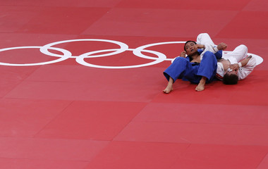Poland's Pawel Zagrodnik fights with Japan's Masashi Ebinuma in their men's -66kg bronze medal A judo match at London 2012 Olympic Games