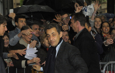 France's President and UMP party candidate for the 2012 French presidential elections Sarkozy arrives at his campaign headquarters in Paris