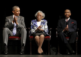 U.S. President Barack Obama applauds the parents of Attorney General Lynch at the Warner Theater in Washington