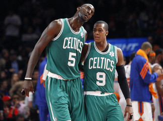 Celtics' Garnett talks with Rondo during a time out against Knicks in the second half during their NBA basketball game in New York