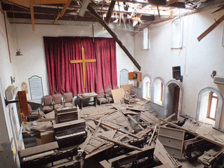 Damages are seen inside a church in the city of Homs
