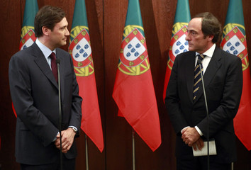 Pedro Passos Coelho and Paulo Portas look at each other during their statement to the press in Lisbon