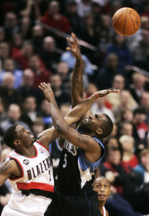 Trail Blazers guard Matthews blocks a shot by Timberwolves guard Webster during NBA basketball game in Portland, Oregon