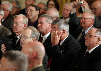 Fellow soldiers from Medal of Honor winner Army Specialist Leslie Sabo Jr. unit watch ceremony in Washington