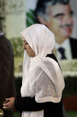 Bahiya, Lebanese MP and sister of Lebanon's assassinated former PM Rafik al-Hariri, prays at his grave in downtown Beirut