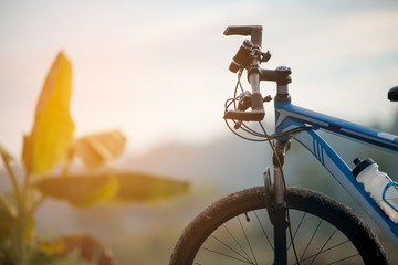 handlebar of a bicycle on sunrise background