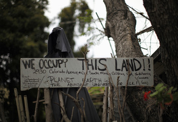 A protest sign is seen outside a trailer home in Village Trailer Park in Santa Monica