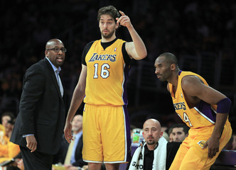 Los Angeles Lakers coach Mike Brown watches their NBA game against the Houston Rockets with Kobe Bryant and Pau Gasol of Spain in Los Angeles