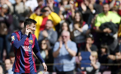 Barcelona's Lionel Messi celebrates a goal against Rayo Vallecano during their Spanish first division soccer match at Camp Nou stadium in Barcelona