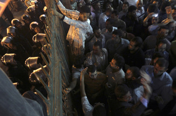 Egypt's Muslim Brotherhood members try to get out side of Al-Fath Mosque during protst anti-Israeli in Cairo