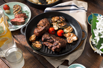 Beef steak grilled in grill pan with grilled vegetables