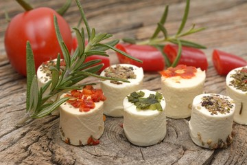Greek feta cheese pieces on wooden background