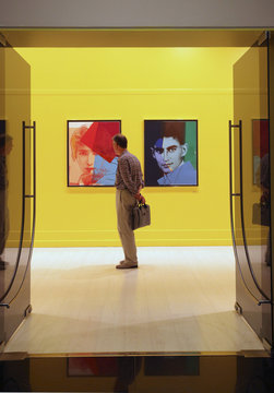 A visitor looks at an artwork at Pera Museum in Istanbul