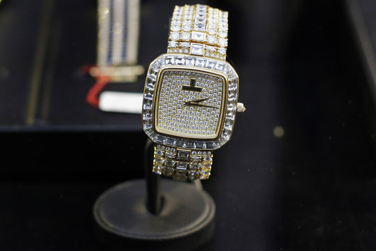 A white gold watch with 300 embedded diamonds, valued at $160,000 and confiscated from Peru's former head of Intelligence Vladimiro Montesinos, is displayed to the media before auction, in Lima