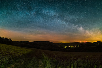 Astro Landscape with the Milky Way as seen from the Odenwald between Lampenhain and Vorderheubach (near Heiligkreuzsteinach) in Germany.