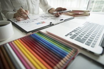 Women draw design sketches in offices