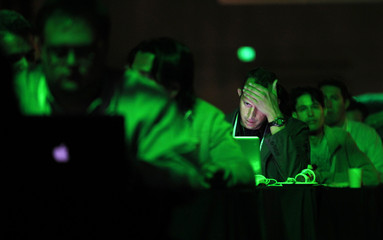 A patron works on his laptop during the Tech Crunch Disrupt conference in San Francisco