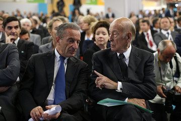 Henri Proglio, Chief Executive Officer of France's state-owned electricity company EDF, and former French President Valery Giscard d'Estaing attend the World Nuclear Exhibition 2014 in Le Bourget