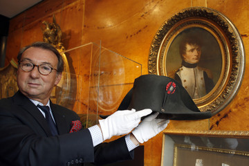 Auctioneer Jean-Pierre Osenat displays a black felt two-cornered hat belonging to French Emperor Napoleon Bonaparte at their auction house in Paris