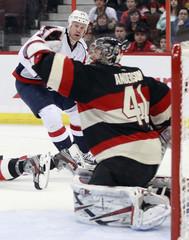 Ottawa Senators' Anderson stops a shot from Washington Capitals' Chimera during the third period of their NHL hockey game in Ottawa