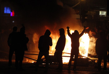 Protesters taunt the police during riots downtown in Bucharest