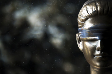 Face of Lady Justice on bokeh background