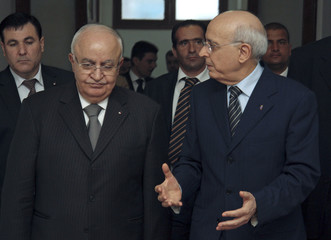 Tunisian Prime Minister Ghannouchi talks to his Syrian counterpart Otri, in Tunis