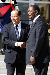 France's President Hollande greets Ivory Coast's President Ouattara in the courtyard of the Elysee Palace in Paris