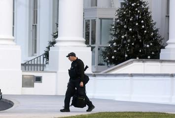 A U.S. Secret Service agent walks at the White House in Washington