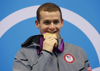 Tyler Clary of the U.S. poses with his gold medal after winning the men's 200m backstroke final during the London 2012 Olympic Games at the Aquatics Centre