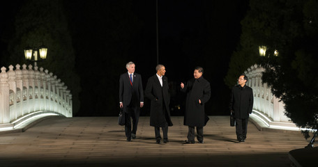 U.S. President Barack Obama and Chinese President Xi Jinping walk together before dinner at Zhongnanhai, during the Asia Pacific Economic Cooperation (APEC) summit in Beijing