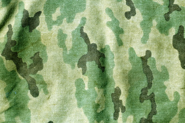 Weathered camouflage uniform pattern.