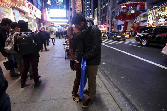 A man and a woman kiss in Times Square in the Manhattan borough of New York