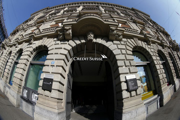 File Photo shows lightning striking over the headquarters of Swiss bank Credit Suisse during a thunderstorm over the Paradeplatz square in Zurich